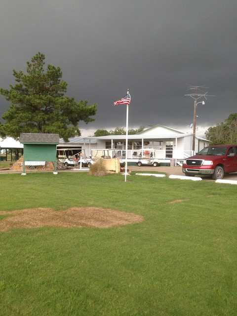 A cloudy day view of the clubhouse at Okemah Golf Course