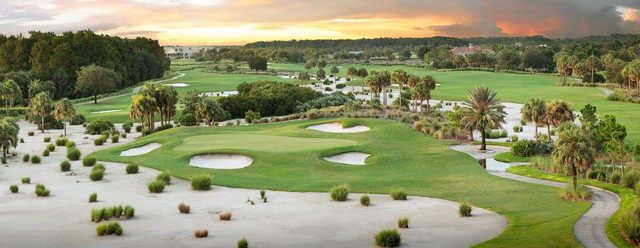 A view of a green protected by sand traps at Talon Course from TwinEagles Golf & Country Club