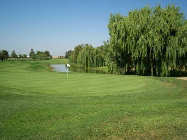A view of green with water in background at Micke Grove Golf Links