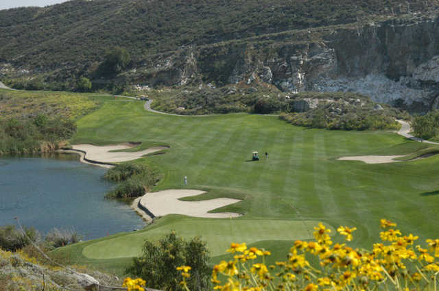 A view of a green with bunkers in background at Oak Quarry Golf Club