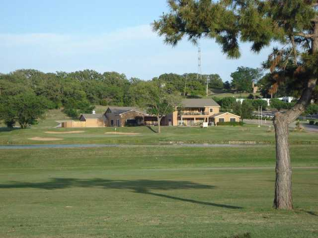 A view of the 18th green and the clubhouse at Mountain Valley Country Club
