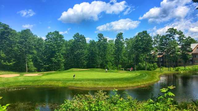A view of the 12th green with bunkers and water coming into play at Shanty Creek