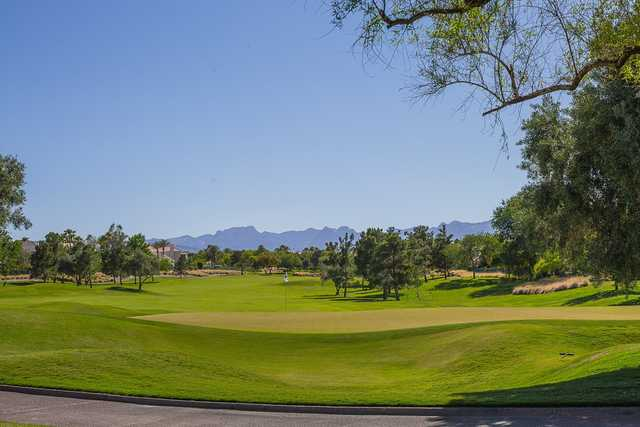 A sunny day view of a green at TPC Summerlin