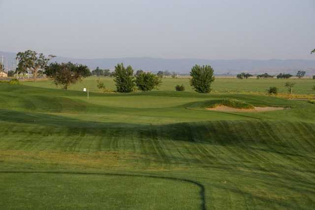 A view of hole #2 with bunker on the right at Wild Wings Golf Club