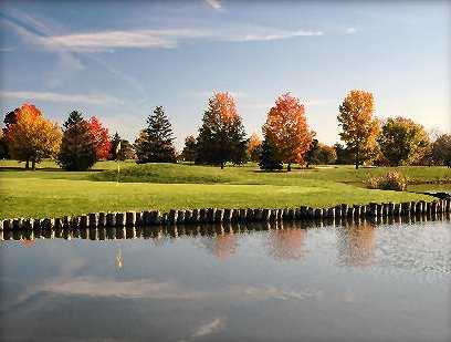 A view over the water of a hole at Green Crest Golf Club