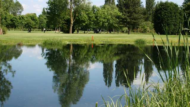 View of a green over water at Haverhill Golf Club