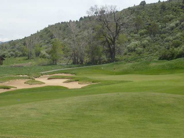 A view of the 4th green with bunkers on the left at Eagle Ranch Golf Club
