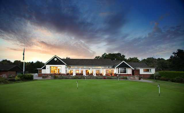 A view of the clubhouse and practice area at Stoneham Golf Club