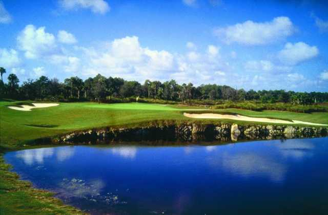 A view of the 5th green with water in foreground at Cypress Course from Bonita Bay East