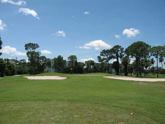 A view of green #13 protected by bunkers at Poinciana Country Club