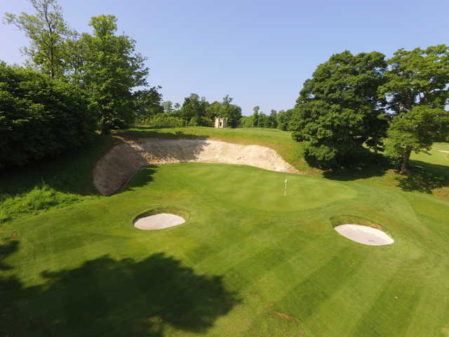 View of a green and bunker at Harleyford Golf Club