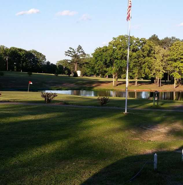 A view of a green with water coming into play at Gilmer Country Club.