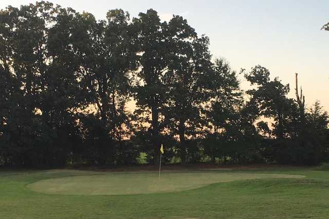 A sunset view of a green at Pine Ridge Golf Course.