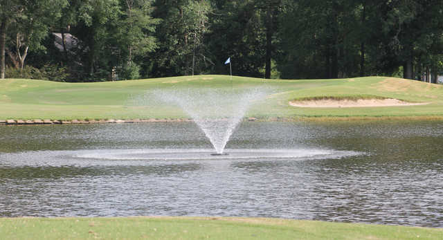 A view of a green with water coming into play at Wildwood Golf Course.