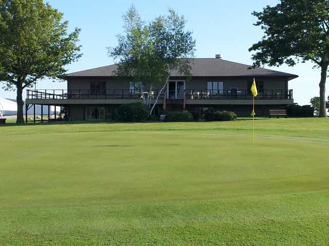 A view of the clubhouse and hole #5 in foreground at Belmond Country Club.