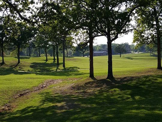 A sunny day view of a fairway at Jerry Tim Brooks Golf Course (Michael Neuroth).