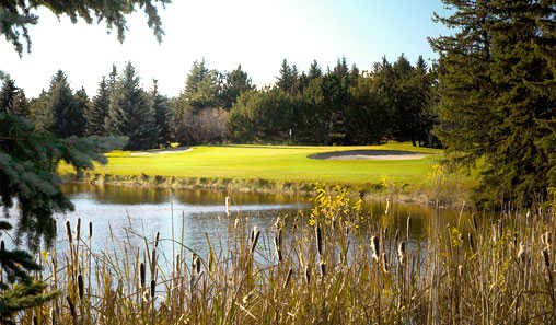 A sunny day view of a green at Little America Resort & Golf.