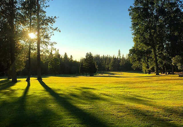 A sunny day view of a fairway at Black Rock Golf Course.