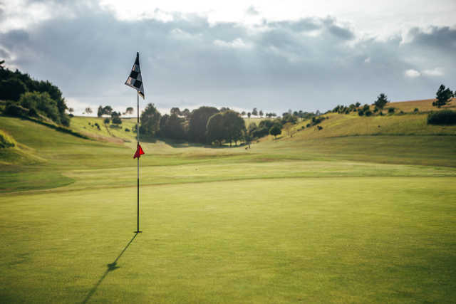 A sunny day view of a hole at Cirencester Golf Club.