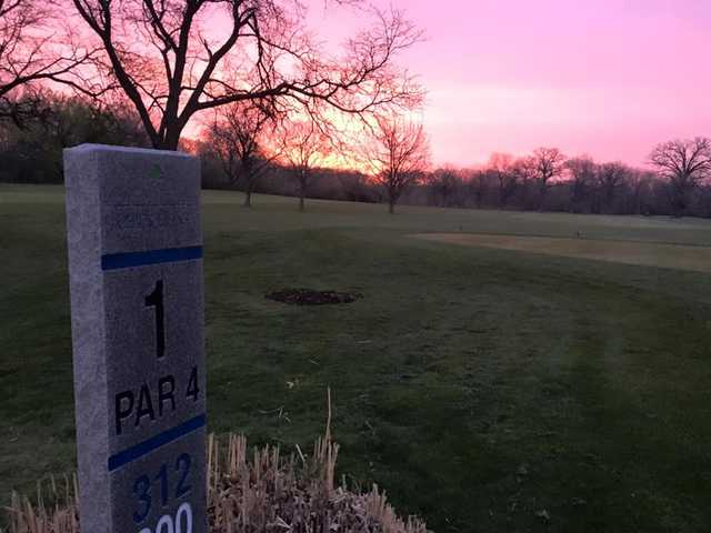 A view from tee #1 sign at Chick Evans Golf Course.