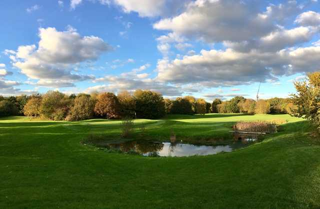 A fall day view of a green at Metro Golf Centre.