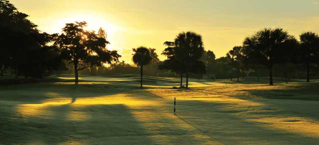 A sunrise view of a green at Indian Spring Country Club.