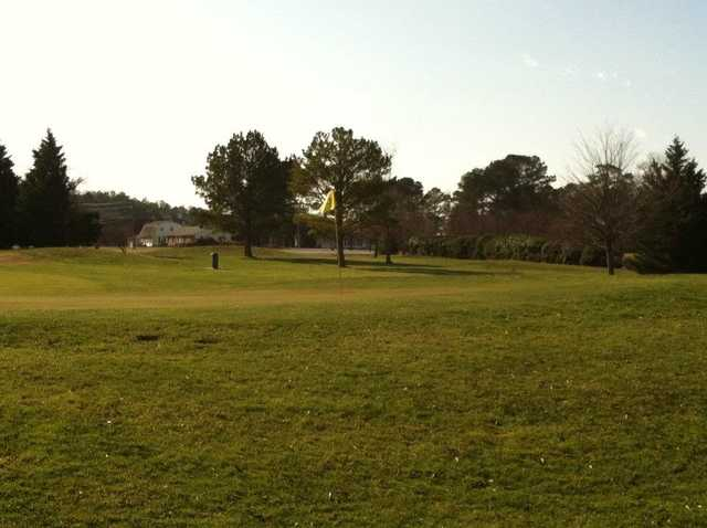 A sunny day view of a hole at Ocean City Golf Club.