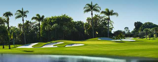 A view of a green with water and bunkers coming into play at Boca Woods Country Club.