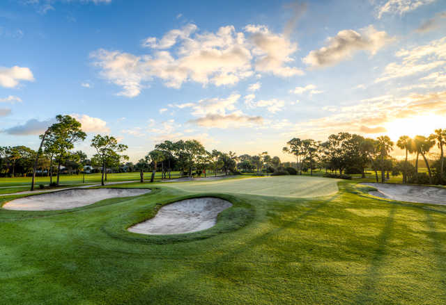 A sunny day view of a green at Turtle Creek Club.
