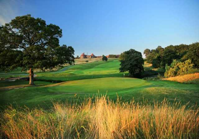 A sunny day view of hole #10 at East Course from East Sussex National.