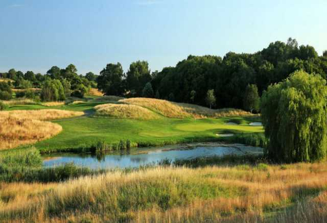 A sunny day view of green #16 at East Course from East Sussex National.