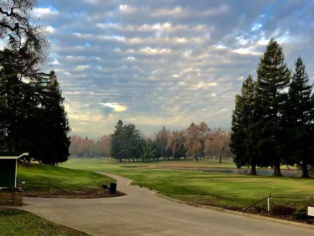 A view of a tee covered by a nice cloud curtain at Ancil Hoffman Golf Course.