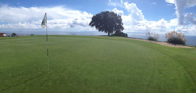 A view of hole #15 with water in the distance at Los Verdes Golf Course.
