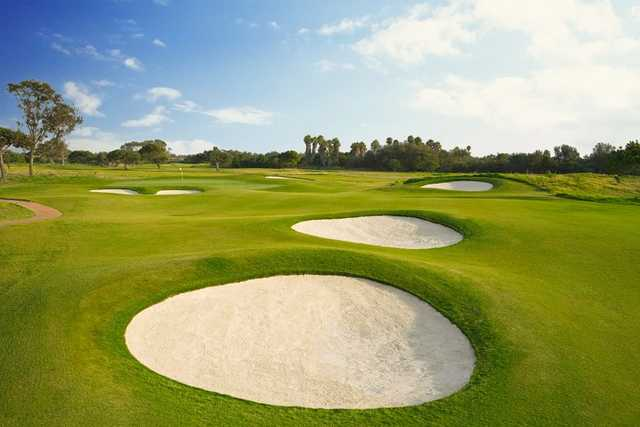 A view of a hole surrounded by tricky bunkers at Olivas Links Golf Course.