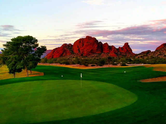 A view of a green and mountains in the distance at Papago Golf Course.