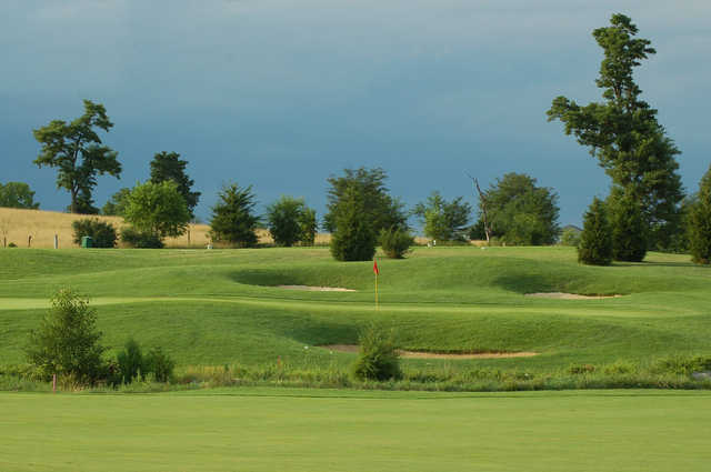 A sunny day view of a hole at Heritage Oaks Golf Course.