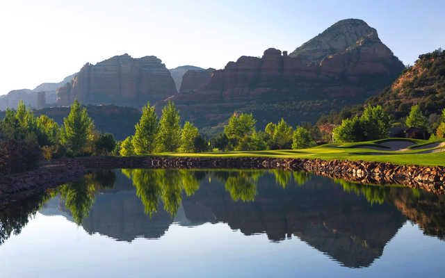 A view over the water of a hole at Seven Canyons Golf Club.