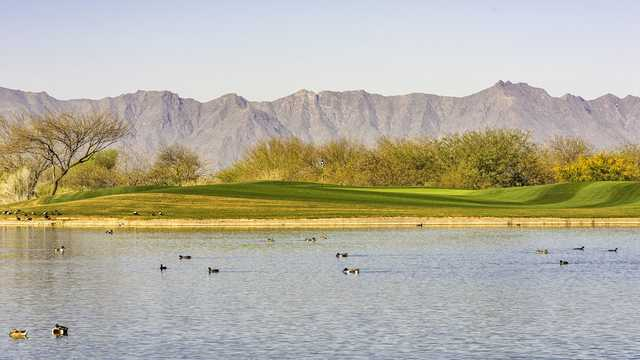 A view over the water of a hole at Whirlwind Golf Club.