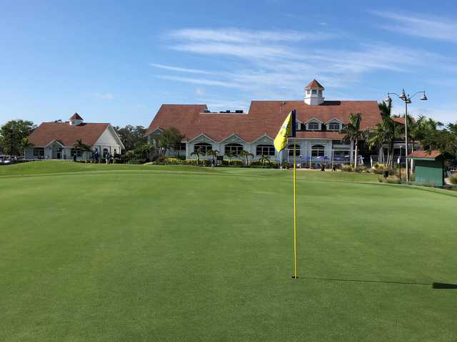 A sunny day view of a green at Fort Myers Country Club.