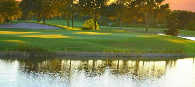 A view of a green with water coming into play at Pelican Sound Golf & River Club.