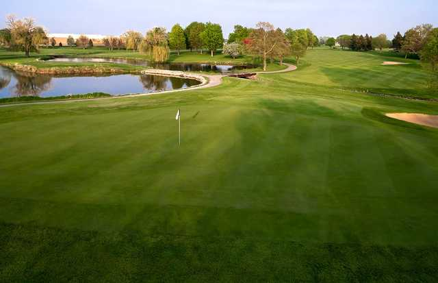 A view of a green with water on the left side at Fox Bend Golf Course.