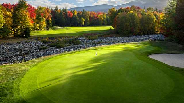 A splendid fall day view of a hole at Sugarloaf Golf Club.