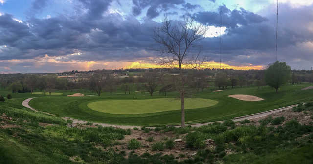 A sunset view of a green at Benson Park Golf Course.
