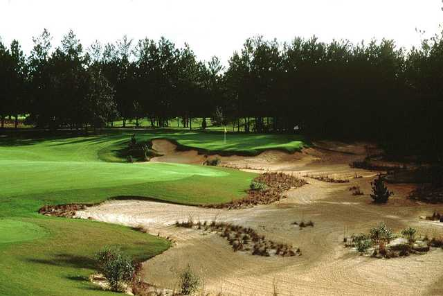 A view of a green surrounded by sand at World Woods Golf Club.