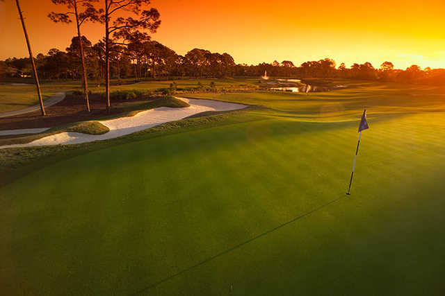 A sunset view of a hole at Plantation Bay Golf and Country Club.