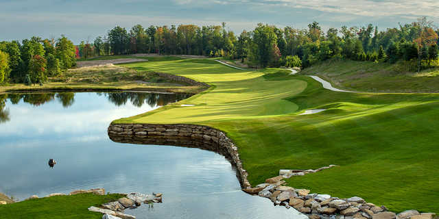 A view of a hole with water on the left side at Shepherd's Rock Golf Course from Nemacolin Woodlands Resort.