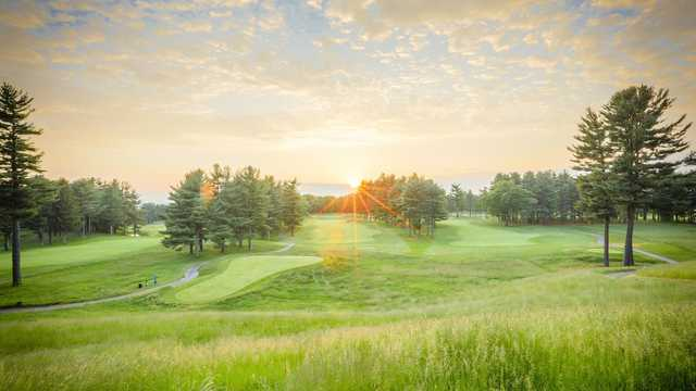 A sunset view of a tee at International Golf Club.