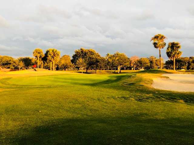 A sunset view of hole #18 at Remington Golf Club.