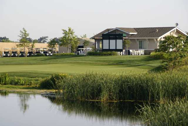 A sunny day view of a green at Wild Wings Golf Club.