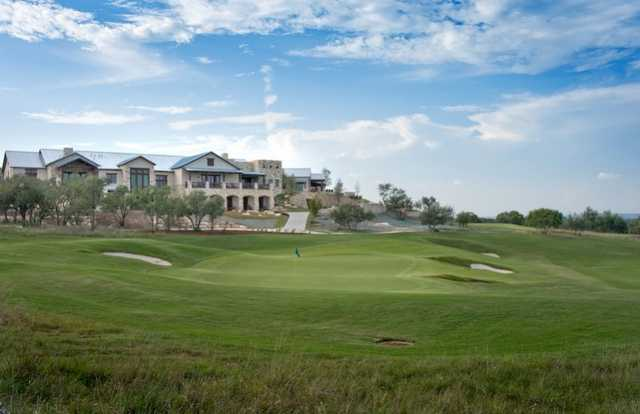 A view of the clubhouse with a green in foreground at Cordillera Ranch Golf Course